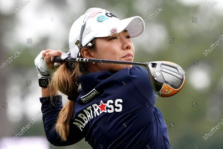 Stock Photo of Jenny Shin, of South Korea, hits off the first tee during the third round of the U.S. Women's Open golf tournament, in Houston