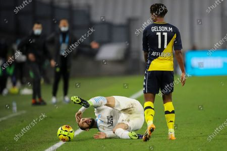 Marseille's Dario Benedetto is knocked to the ground by Monaco's Gelson Martins during the French League One soccer match between Marseille and Monaco at the Stade Velodrome in Marseille, southern France