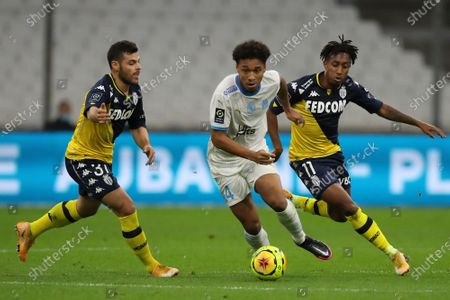 Marseille's Boubacar Kamara battles for the ball with Monaco's Gelson Martins, right, and Monaco's Kevin Volland, left, during the French League One soccer match between Marseille and Monaco at the Stade Velodrome in Marseille, southern France