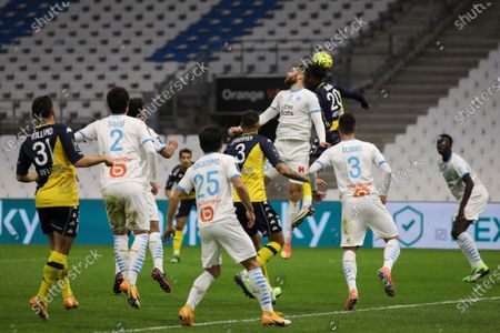 Monaco's Axel Disasi, top right, and Marseille's Duje Caleta-Car jump for the ball during the French League One soccer match between Marseille and Monaco at the Stade Velodrome in Marseille, southern France