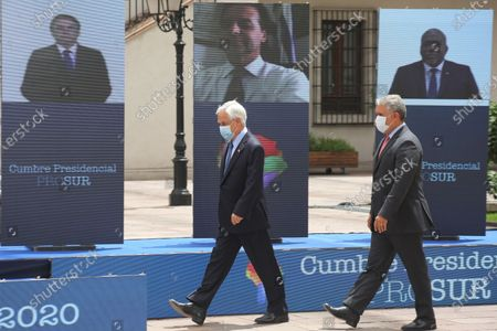 Stock Image of The President of Chile, Sebastian Pinera (L), and the President of Colombia, Ivan Duque (R), walk to the podium to take the official photos of the Prosur Summit, at the Palacio de La Moneda, in Santiago, Chile, 12 December 2020. Pinera, who received Duque, the previous day to head the 15th Summit of the Pacific Alliance, handed over the pro tempore presidency of the Forum for the Progress of South America (Prosur), to the Colombian president on 2020.