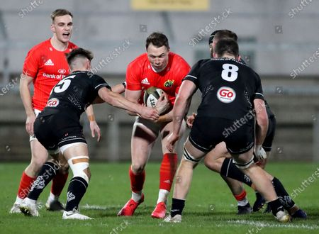 Ulster A vs Munster A. Ulster A's Ethan McIIroy and Nick Timoney tackle Sean French of Munster A