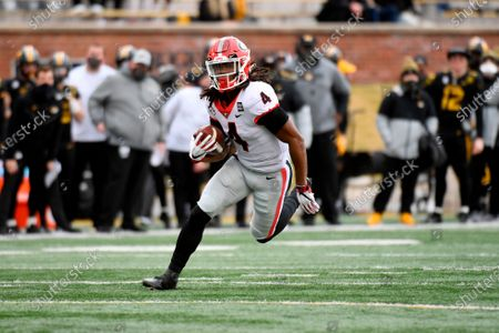 Georgia running back James Cook heads for the end zone after catching a 37-yard pass for a touchdown during the first half of an NCAA college football game against Missouri, in Columbia, Mo