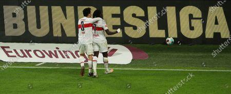 Stuttgart's Wataru Endo, left, and Tanguy Coulibaly celebrate during the German Bundesliga soccer match between Borussia Dortmund and VfB Stuttgart in Dortmund, Germany