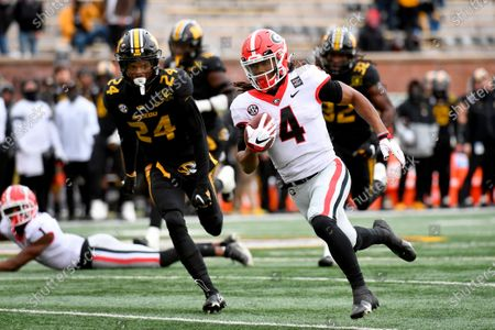 Georgia running back James Cook (4) runs past Missouri defensive back Ishmael Burdine (24) on his way to a touchdown during the first half of an NCAA college football game, in Columbia, Mo