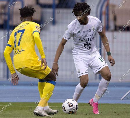 Al Ahli player Salman Al Moasher (R) in action against Al Nassr player Abdullah Al khaibari during the Saudi Professional League soccer match between Al Nassr and Al Ahli at King Fahd Stadium, Riyadh, Saudi Arabia, 12 December 2020.