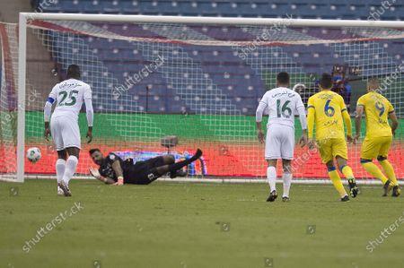Al Ahli goalkeeper Mohammed Al Owais concedes a goal during the Saudi Professional League soccer match between Al Nassr and Al Ahli at King Fahd Stadium, Riyadh, Saudi Arabia, 12 December 2020.
