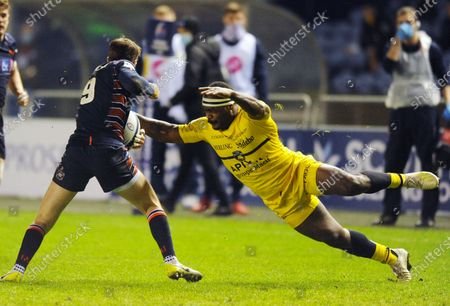 Levani Botia - La Rochelle centre dives tackles Henry Pyrgos as the Edinburgh scrum half attempts to break out of his 22.