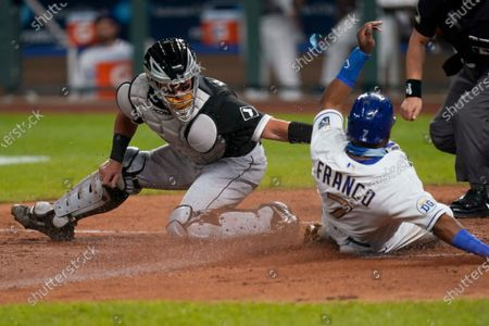 Stock Photo of Chicago White Sox catcher James McCann, left, misses the tag on Kansas City Royals' Maikel Franco (7), who scores during the fourth inning of a baseball game in Kansas City, Mo. Free agent catcher James McCann and the New York Mets were close to completing a $40 million, four-year contract, as the team continues to upgrade its roster under new owner Steve Cohen. A person close to the deal confirmed the details to The Associated Press under condition of anonymity because there was no official announcement
