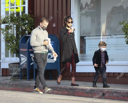 Mason Morfit and Jordana Brewster are seen carrying coffee on their morning walk