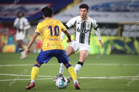 STVV's Lee Seung-woo and Charleroi's Amine Benchaib fight for the ball during a soccer match between Sint-Truiden VV and Sporting Charleroi, Saturday 12 December 2020 in Sint-Truiden, on day 16 of the 'Jupiler Pro League' first division of the Belgian championship.