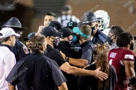 Stock Picture of Troy head coach Chip Lindsey and Coastal Carolina head coach Jamey Chadwell embrace at midfield after an NCAA college football game, in Troy, Ala