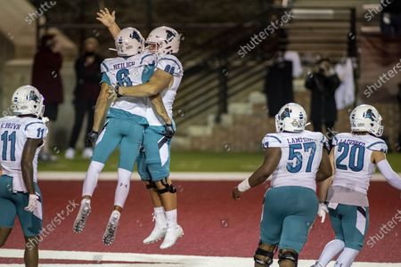 Coastal Carolina wide receiver Jaivon Heiligh (6) and teammate Will McDonald (66) celebrate Heiligh's touchdown against Troy during the second half of an NCAA college football game, in Troy, Ala