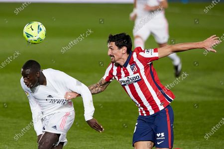 Stock Photo of Ferland Mendy of Real Madrid and Stefan Savic of Atletico de Madrid