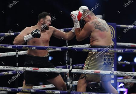 Hughie Fury of Britain (L) and Mariusz Wach of Poland during the first round of their heavyweight bout  at the SSE Arena in London, Britain, 12 December 2020.