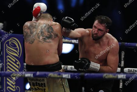Hughie Fury of Britain (R) and Mariusz Wach of Poland during the first round of their heavyweight bout at the SSE Arena in London, Britain, 12 December 2020.