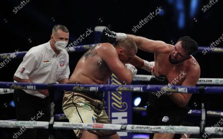 Hughie Fury of Britain (R) and Mariusz Wach of Poland during their heavyweight bout at the SSE Arena in London, Britain, 12 December 2020.