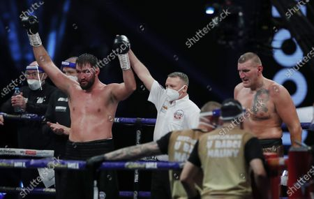 Hughie Fury of Britain (L) is declared winner on points, defeating Mariusz Wach of Poland in their heavyweight bout at the SSE Arena in London, Britain, 12 December 2020.
