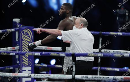 Lawrence Okolie of Britain is sent to his corner after knocking down Nikodem Jezewski of Poland for the second time during their WBO International Cruiserweight Title bout with at the SSE Arena in London, Britain, 12 December 2020.