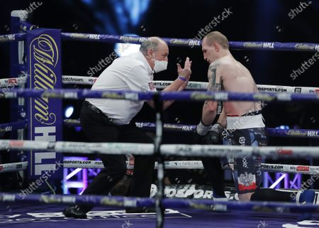 Stock Image of The referee gives a count to Nikodem Jezewski of Poland after he was knocked down by Lawrence Okolie of Britain for the second time during their WBO International Cruiserweight Title bout with at the SSE Arena in London, Britain, 12 December 2020.