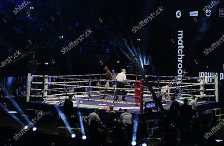 Stock Photo of Lawrence Okolie of Britain (L) heads to his corner after knocking down Nikodem Jezewski of Poland in the second round during their WBO International Cruiserweight Title bout with at the SSE Arena in London, Britain, 12 December 2020.