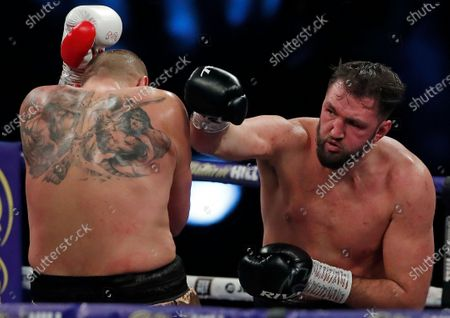 Britain's Hughie Fury, right, throws a punch at Poland's Mariusz Wach during their Heavyweight boxing fight at Wembley Arena in London
