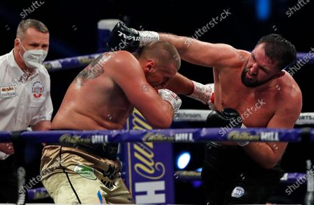 Stock Picture of Britain's Hughie Fury, right, throws a punch at Poland's Mariusz Wach during their Heavyweight boxing fight at Wembley Arena in London