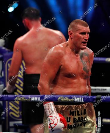 Stock Image of Poland's Mariusz Wach, right, walks back to his corner at the end of a round against Britain's Hughie Fury during their Heavyweight boxing fight at Wembley Arena in London