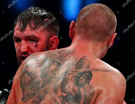 Stock Photo of Poland's Mariusz Wach, right, and Britain's Hughie Fury during their Heavyweight boxing fight at Wembley Arena in London