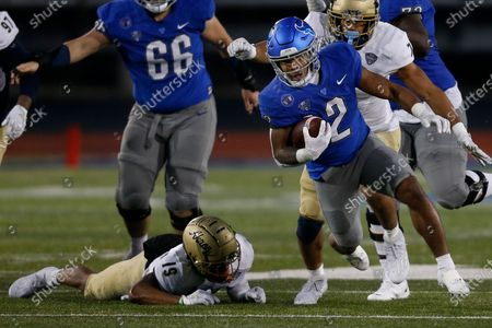 Buffalo running back Ron Cook Jr. gets past Akron safety MyJaden Horton (19) during the second half of an NCAA college football game in Amherst, N.Y