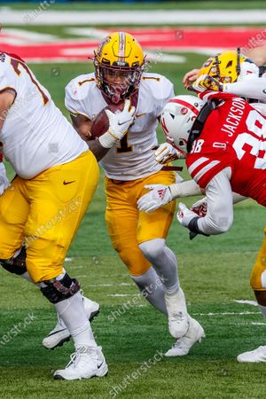 Stock Picture of Lincoln, NE. U.S. - Minnesota Golden Gophers running back Cam Wiley #1 breaks through the line of scrimmage in action during a NCAA Division 1 football game between Minnesota Golden Gophers and the Nebraska Cornhuskers at Memorial Stadium in Lincoln, NE. .Minnesota won 24-17