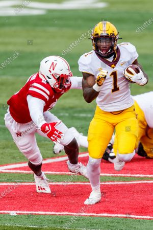 Lincoln, NE. U.S. - Minnesota Golden Gophers running back Cam Wiley #1 breaks through the line of scrimmage as Nebraska Cornhuskers linebacker Caleb Tannor #2 reaches to tackle in action during a NCAA Division 1 football game between Minnesota Golden Gophers and the Nebraska Cornhuskers at Memorial Stadium in Lincoln, NE. .Minnesota won 24-17