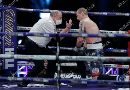 Stock Picture of Poland's Nikodem Jezewski takes a count as his fights Britain's Lawrence Okolie in a Cruiserweight boxing bout at Wembley Arena in London