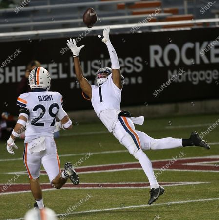 Stock Image of Virginia's Nick Grant, right, attempts to intercept a pass from Virginia Tech quarterback Braxton Burmeister during the first half of an NCAA college football game, in Blacksburg, Va