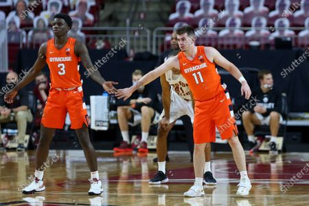 Chestnut Hill, MA, USA; Syracuse Orange forward Kadary Richmond (3) and Syracuse Orange guard Joseph Girard III (11) during the NCAA basketball game between Syracuse Orange and Boston College Eagles at Conte Forum