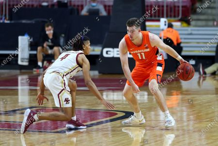Chestnut Hill, MA, USA; Syracuse Orange guard Joseph Girard III (11) defended by Boston College Eagles guard Makai Ashton-Langford (4) during the NCAA basketball game between Syracuse Orange and Boston College Eagles at Conte Forum