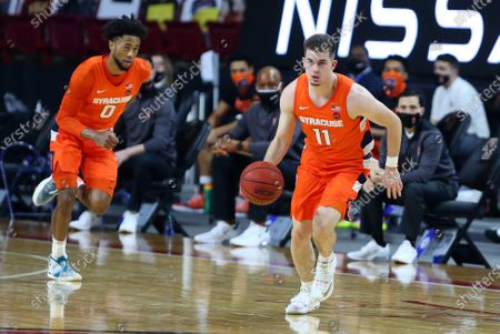 Chestnut Hill, MA, USA; Syracuse Orange guard Joseph Girard III (11) fast-breaks during the NCAA basketball game between Syracuse Orange and Boston College Eagles at Conte Forum