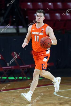 Stock Photo of Chestnut Hill, MA, USA; Syracuse Orange guard Joseph Girard III (11) in action during the NCAA basketball game between Syracuse Orange and Boston College Eagles at Conte Forum