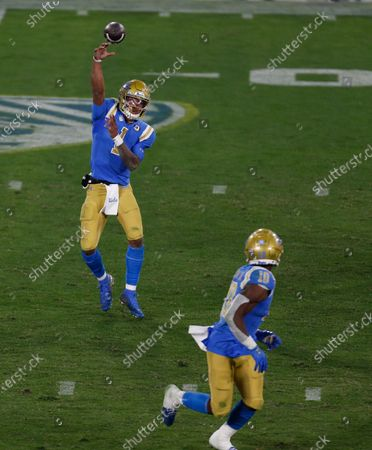 Stock Photo of UCLA Bruins quarterback Dorian Thompson-Robinson (1) throws a pass during the NCAA football game between the USC Trojans and the UCLA Bruins at the Rose Bowl in Pasadena, California. Mandatory Photo Credit : Charles Baus/CSM
