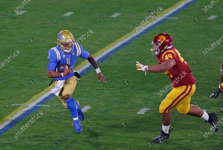 UCLA Bruins quarterback Dorian Thompson-Robinson (1) scrambles with the ball during the NCAA football game between the USC Trojans and the UCLA Bruins at the Rose Bowl in Pasadena, California. Mandatory Photo Credit : Charles Baus/CSM