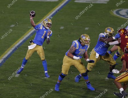 Stock Image of UCLA Bruins quarterback Dorian Thompson-Robinson (1) throws a pass during the NCAA football game between the USC Trojans and the UCLA Bruins at the Rose Bowl in Pasadena, California. Mandatory Photo Credit : Charles Baus/CSM