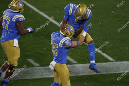 UCLA Bruins wide receiver Ethan Fernea (36) celebrates UCLA Bruins quarterback Dorian Thompson-Robinson (1) after scoring a touchdown during the NCAA football game between the USC Trojans and the UCLA Bruins at the Rose Bowl in Pasadena, California. Mandatory Photo Credit : Charles Baus/CSM