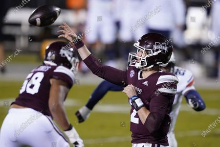 Mississippi State quarterback Will Rogers (2) throws a pass against Auburn during the first half of an NCAA college football game, in Starkville, Miss
