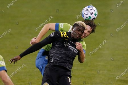 Stock Image of Columbus Crew's Gyasi Zardes, front, and Seattle Sounders' Gustav Svensson go for a head ball during the second half of the MLS Cup championship game, in Columbus, Ohio. The Crew won 3-0