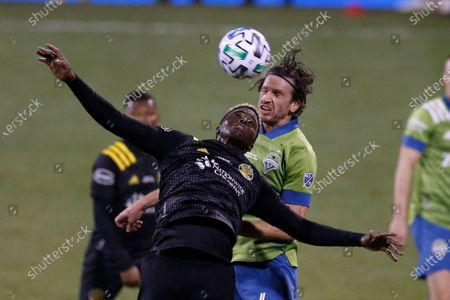Columbus Crew's Gyasi Zardes, front, and Seattle Sounders' Gustav Svensson vie for a head ball during the second half of the MLS Cup championship game, in Columbus, Ohio. The Crew won 3-0