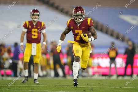 Southern California running back Stephen Carr, right, runs the ball from quarterback Kedon Slovis (9) during the third quarter of an NCAA college football game against UCLA, in Pasadena, Calif