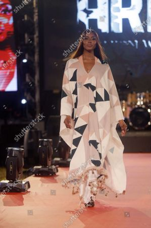 British model Naomi Campbell displays an outfit by Designer TZAR STUDIOS during the ARISE Fashion Week event in Lagos, Nigeria early