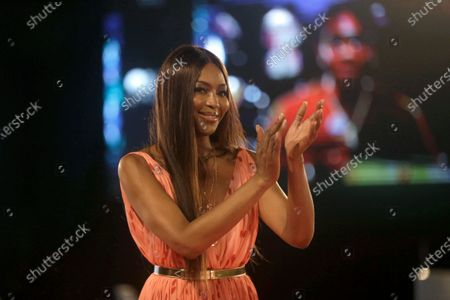 British model Naomi Campbell applauds during ARISE Fashion Week event in Lagos, Nigeria early