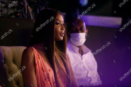 British model Naomi Campbell, left, attends ARISE Fashion Week event in Lagos, Nigeria early Sunday, Dec.13, 2020