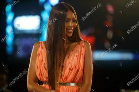 British model Naomi Campbell smiles during ARISE Fashion Week event in Lagos, Nigeria early